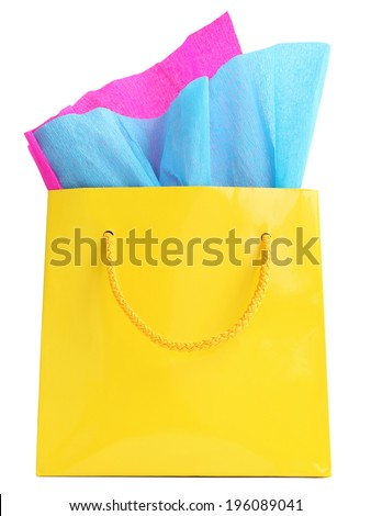 Yellow glossy shopping bag with pink and blue wrapping paper in it, isolated on white - stock photo
