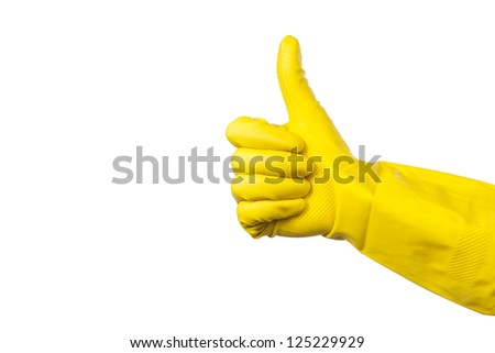 yellow glove for cleaning on womans arm show thumbs up - stock photo