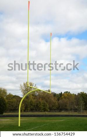 Yellow Goal Posts on American Football Field - stock photo