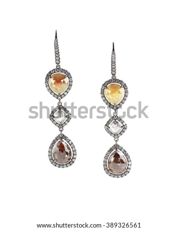 Yellow gold and diamond earrings isolated on white quartz and amber - stock photo