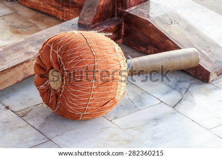 Yellow gong hammer,drum stick - stock photo
