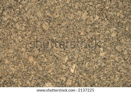 Yellow granite texture close-up (sepia mode) - stock photo