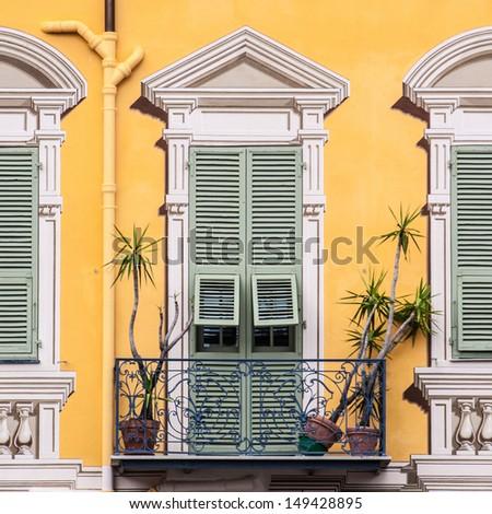 Yellow graphical vintage facade. - stock photo