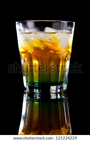 Yellow green alcohol cocktail isolated on black