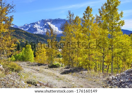 yellow, green and red aspens and colourful mountains of Colorado during foliage season