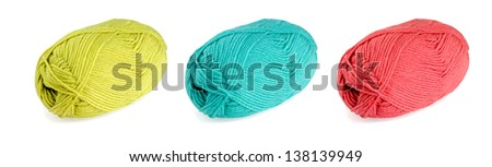 yellow, green and red skeins of wool isolated on white background