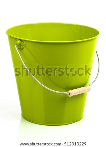 Yellow - green iron/metal bucket/pail/container with handle isolated on white background. Colorful kid child toys. Garden equipment.