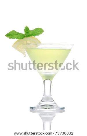 Yellow green martini Mojito Cocktail drink with light rum, lime, spring of mint, club soda and syrup in cocktails martinis glass isolated on a white background - stock photo