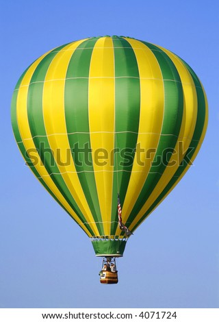 Yellow & Green Striped Hot Air Balloon Lifting Off