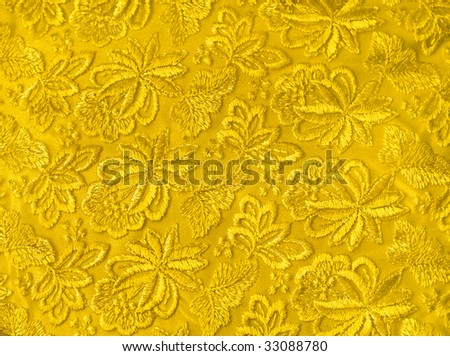 Yellow guipure, embroidery on cloth, texture - stock photo