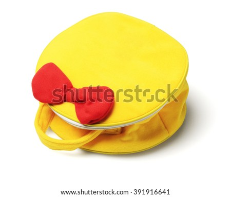 Yellow Hand Bag with Red Ribbon Lying on White Background - stock photo