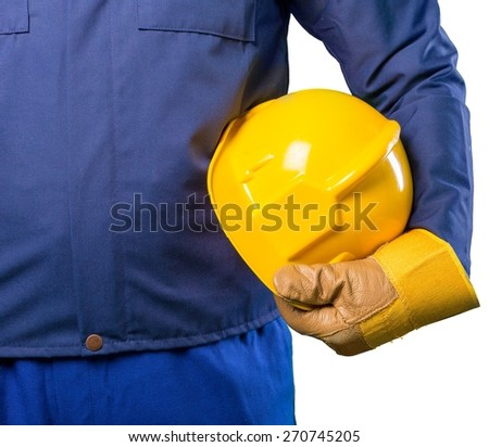 Yellow. Hand of worker with yellow hard-hat,natural light - stock photo