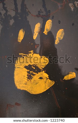 Yellow hand on black surface.