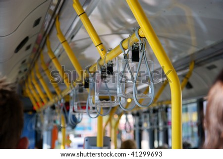 yellow handle in city bus - stock photo