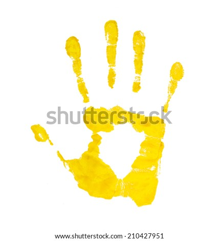 yellow handprint on an isolated white background - stock photo