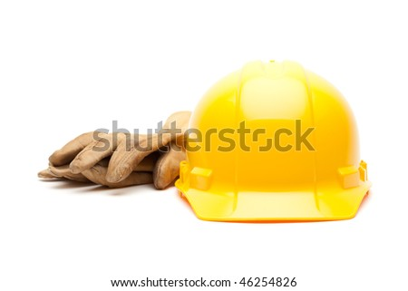 Yellow Hard Hat and Gloves Isolated on White. - stock photo