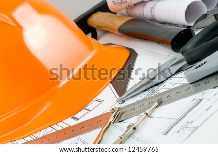 Yellow hard hat and working tools - stock photo