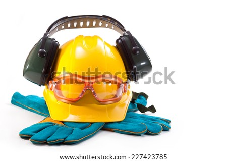 Yellow hard hat, earphones against noise, goggles and gloves on a white background - stock photo