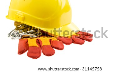 Yellow hard hat, protective gloves and steel chain isolated.