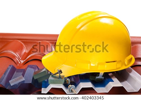 Yellow hard hat ,roof of different shapes and colors, screws on a white background - stock photo