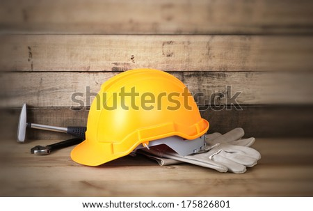Yellow hardhat and old leather gloves