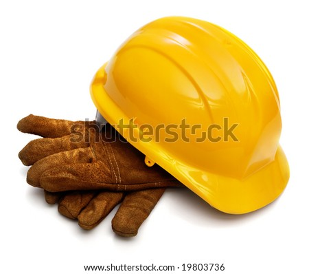 Yellow hardhat and old leather gloves isolated on white background - stock photo