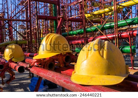 yellow hardhat on construction site - stock photo