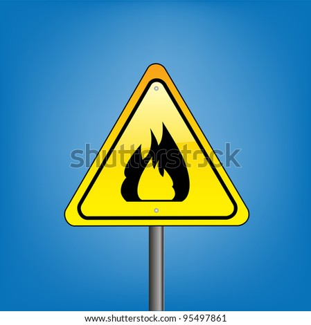 Yellow hazard warning sign on against blue sky - open flame warning - stock photo