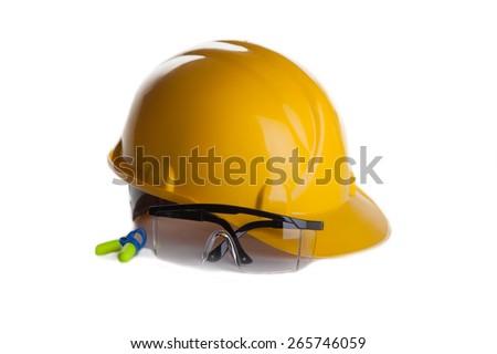 yellow helmet and protecting eye glasses - stock photo