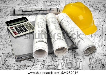 Yellow helmet, calculator, grey folder document and project drawings