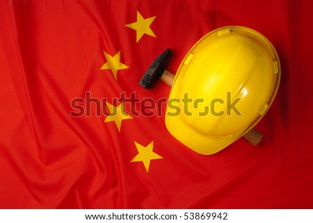 Yellow helmet covering the China flag symbol - stock photo