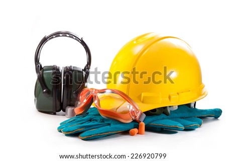 Yellow helmet, gloves and goggles with headphones on white background - stock photo