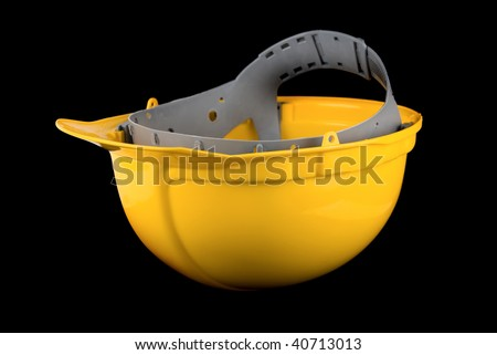 Yellow helmet isolated on a black background - stock photo