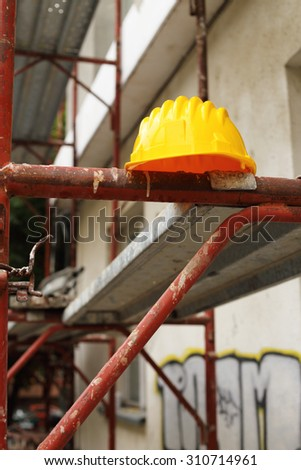 Yellow helmet on work place  - stock photo