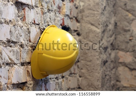 Yellow helmet  on work place,shallow dof