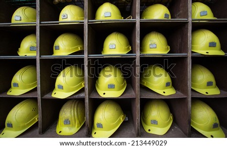 yellow helmets in shelf  - stock photo