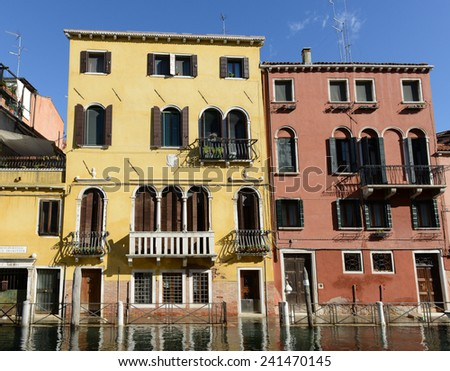 Yellow Home along the Grand Canal in Venice Italy - stock photo