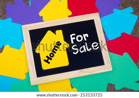 Yellow home sign on the blackboard: Real Estate Concept, Home for sale - stock photo