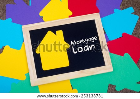 Yellow home sign on the blackboard: Real Estate Concept, Mortgage loan - stock photo