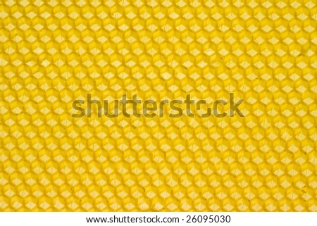 Yellow honeycomb prepared for bees to start building combs - stock photo