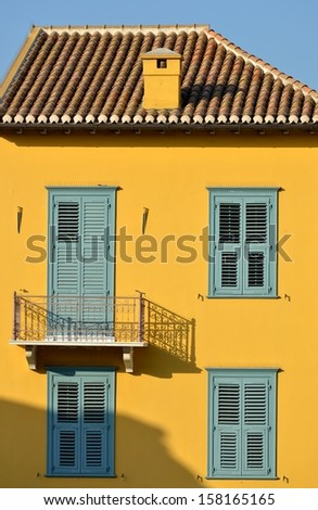 Yellow house Athens - stock photo