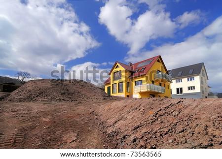 Yellow house under construction - stock photo
