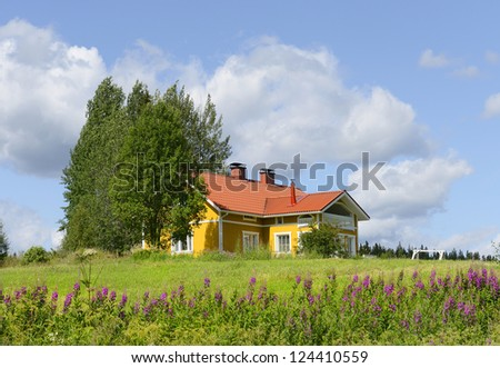 Yellow house with a red roof on the hill. Finland - stock photo