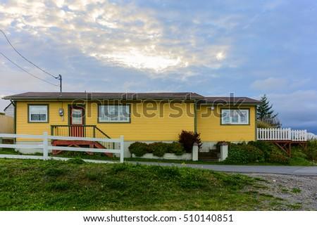 yellow house red door stock photo 510140851 - shutterstock