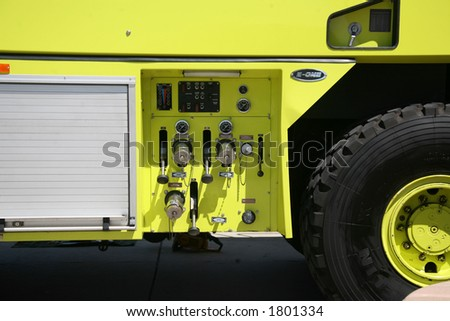 Yellow Humvee Firetruck on Aerospace Plant - stock photo