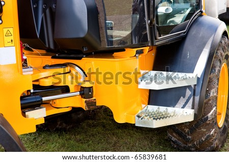 Yellow Hydraulic Excavator Articulation Mechanism Side View