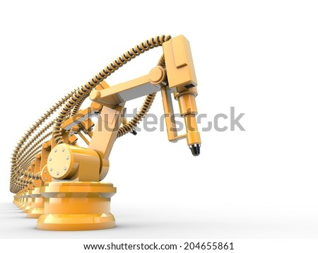Yellow industrial robots are operating.