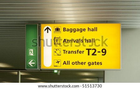 Yellow information board at international airport - stock photo