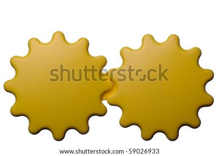 Yellow interlocking gears. Baby toy isolated on white. - stock photo