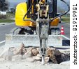 yellow jackhammer on building site in summer - stock photo